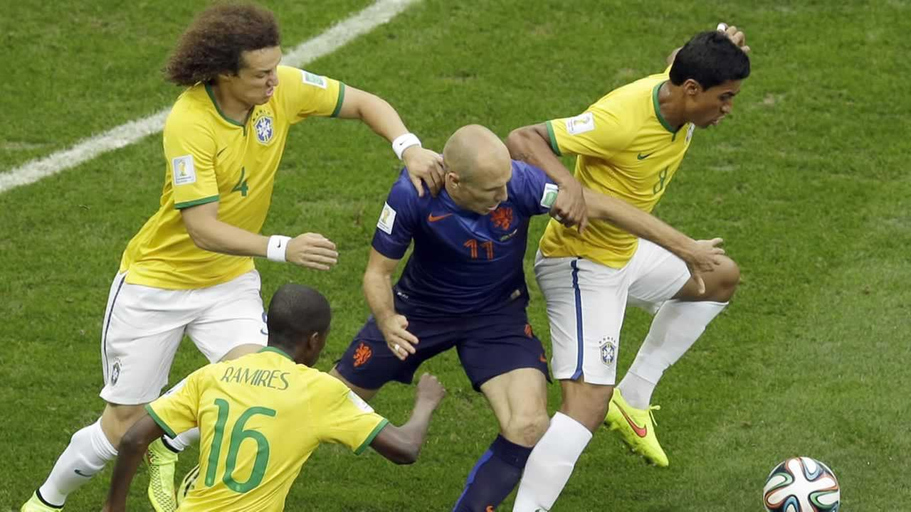 Netherlands Arjen Robben fights for the ball with Brazils Paulinho (AP Photo/Themba Hadebe)