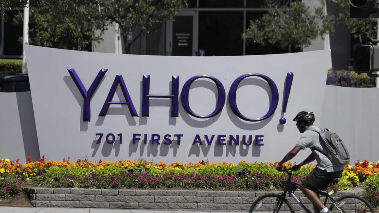 In this Tuesday, July 19, 2016 file photo, a cyclist rides past a Yahoo sign at the companys headquarters in Sunnyvale, Calif.