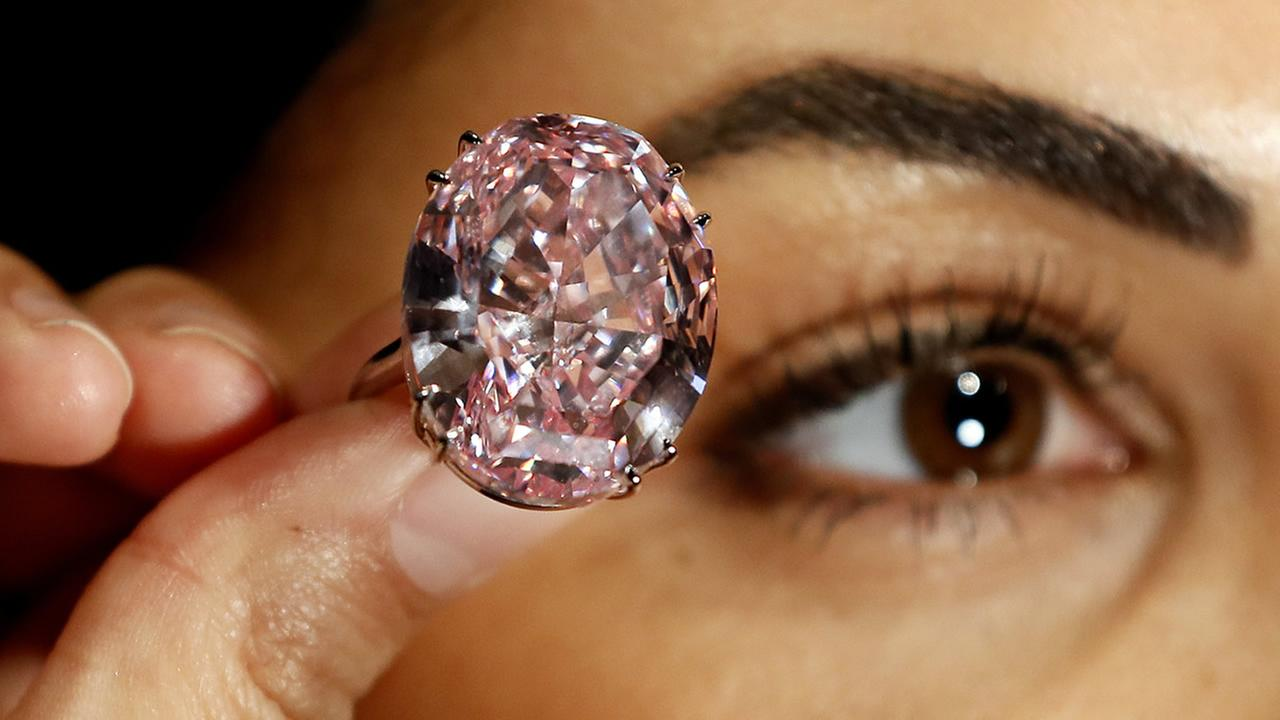 The Pink Star diamond is displayed by a model at Sothebys auction rooms in London, Monday, March 20, 2017. (AP Photo/Kirsty Wigglesworth)