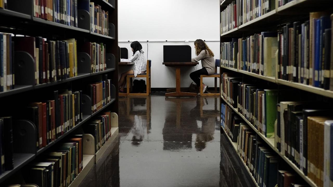 In this Friday, Oct. 19, 2012 file photo, students study in a library on the campus of California State University, Long Beach in Long Beach, Calif.