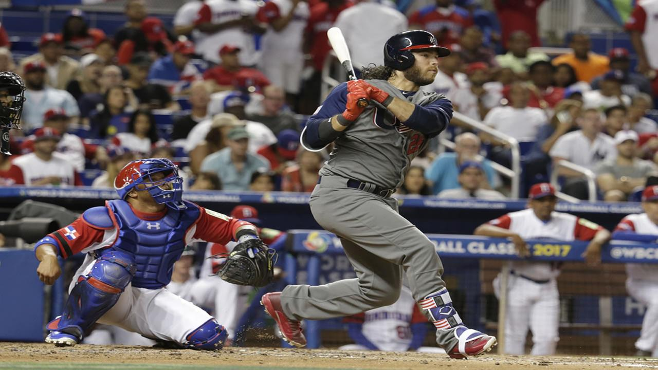 United States Brandon Crawford (26) bats as Dominican Republic catcher Welington Castillo looks on during a first-round game of the World Baseball Classic, Saturday, March 11, 2017, in Miami.