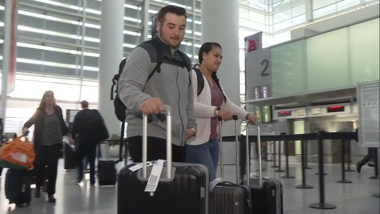Two travelers head to London from San Francisco International Airport on March, 22, 2017.