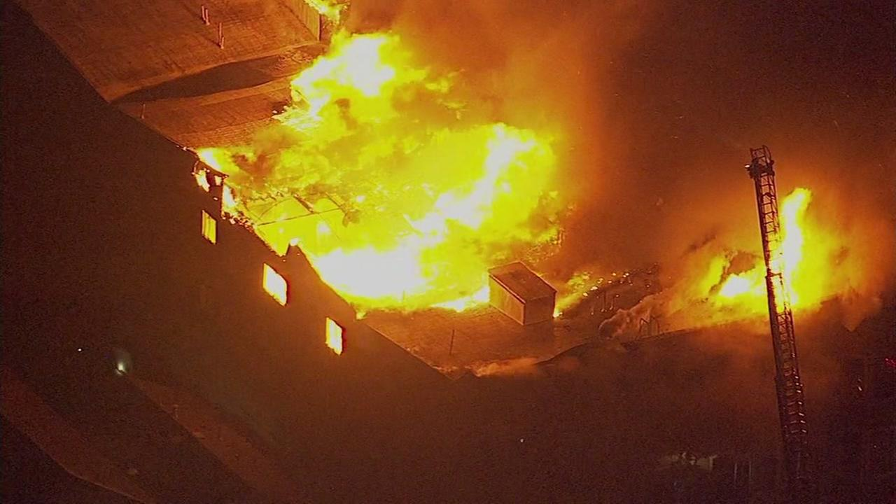Firefighters battle massive fire on Mead Avenue in Oakland, California, Monday, March 27, 2017.
