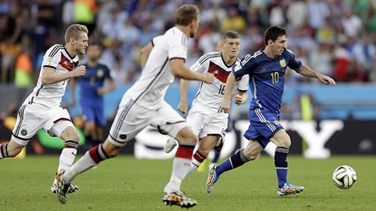 German defenders chase Argentinas Lionel Messi