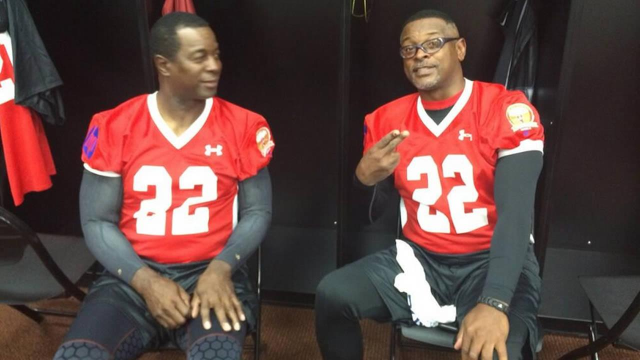 Dwight Hicks  and Tim McKyer reliving old times.