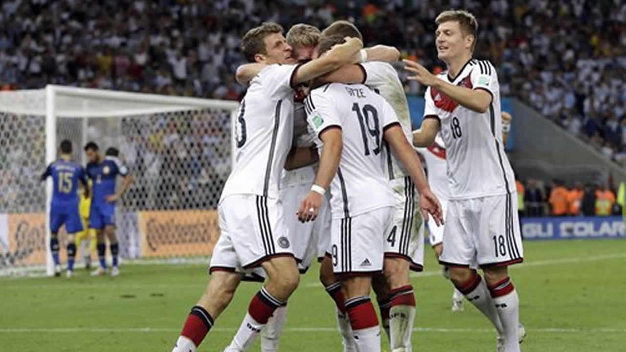 Germanys Mario Goetze, 19, is congratulated by his teammates