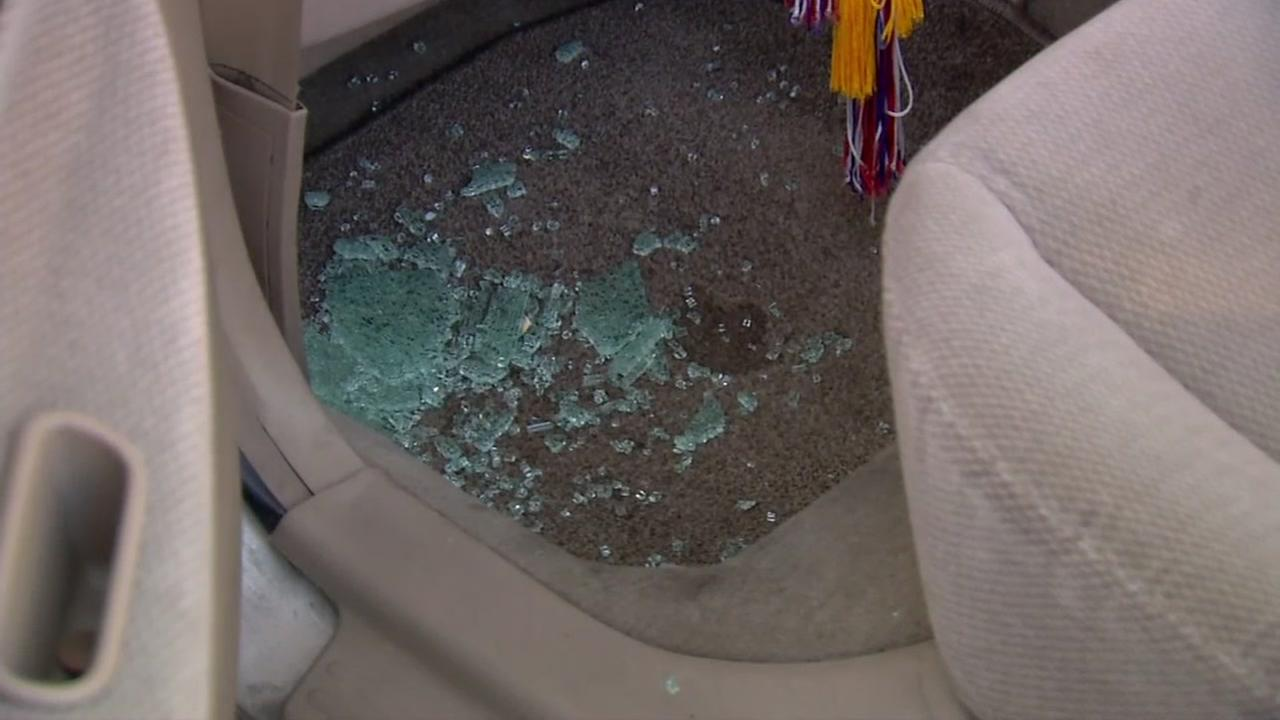 Glass appears on the floor of a car in Fremont, Calif. after a rash of break-ins on March, 28, 2017.