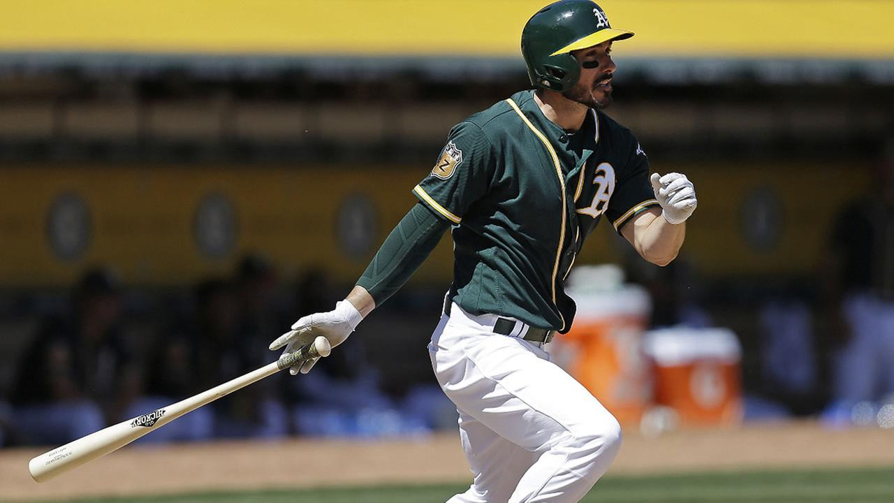 Athletics Matt Joyce swings during a baseball game Saturday, April 1, 2017, in Oakland, Calif. (AP Photo/Ben Margot)