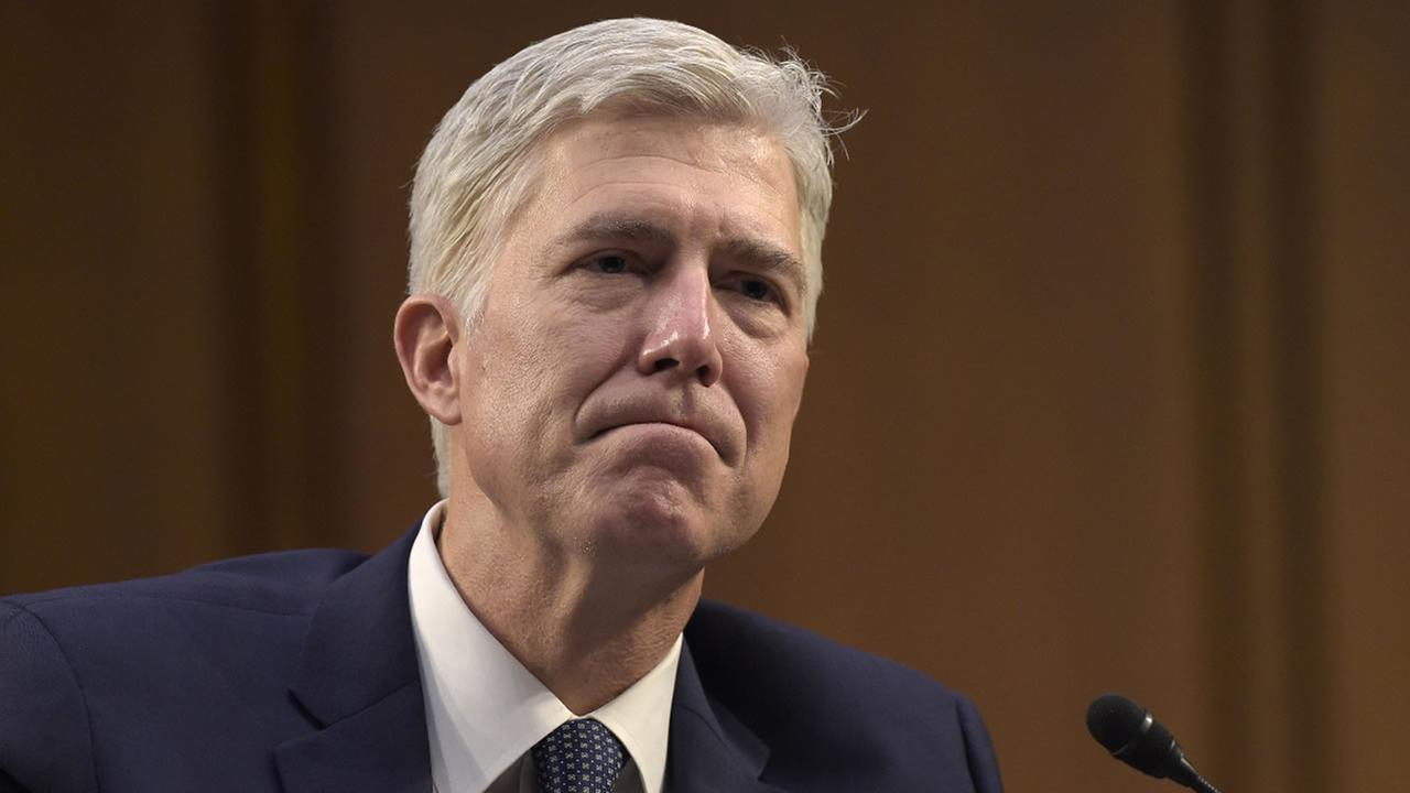 In this Wednesday, March 22, 2017, file photo, Supreme Court Justice nominee Neil Gorsuch listens as he is asked a question on Capitol Hill in Washington.