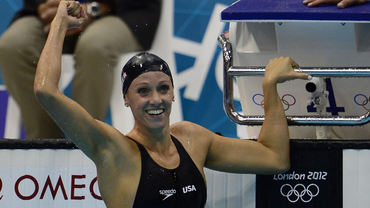 United States Dana Vollmer celebrates her gold medal finish in the womens 100-metre butterfly at the Aquatic Centre in the Olympic Village at the 2012 Summer Olympics in London on Sunday, July 29, 2012. (AP Photo/Sean Kilpatrick, Canadian Press)