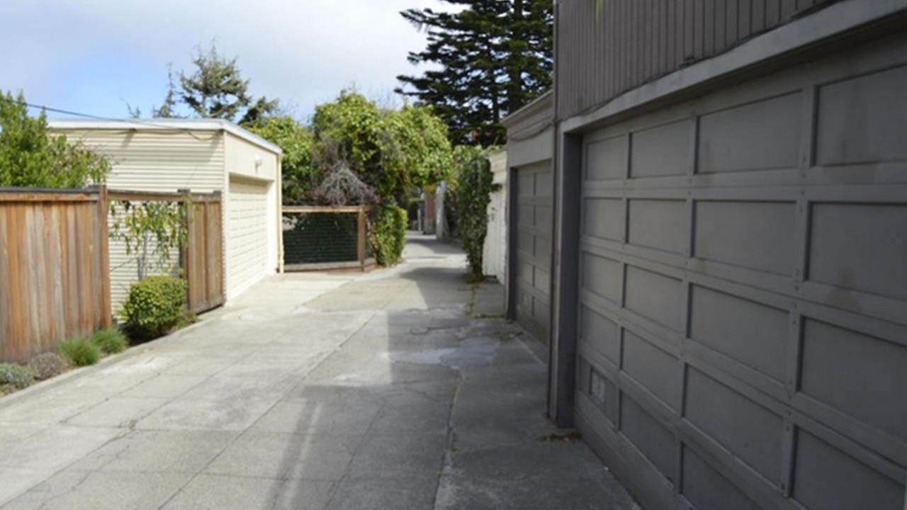 This image shows a driveway thats listed for sale in San Francisco for $35,000.