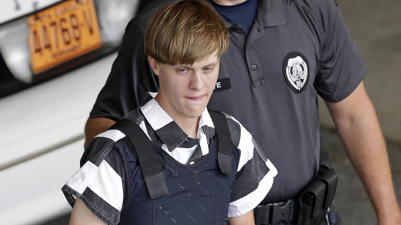 In this June 18, 2015 file photo, Charleston, S.C., shooting suspect Dylann Roof is escorted from the Cleveland County Courthouse in Shelby, N.C.