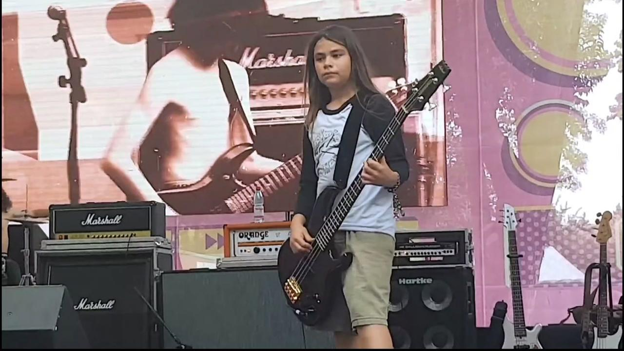 Tye Trujillo plays bass on stage in this undated photo.