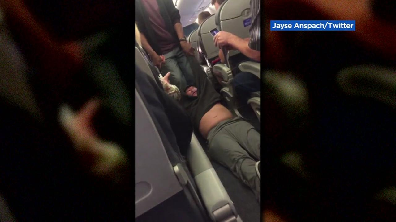 A United Airlines passenger is dragged off of his flight when he refused to give up his seat in this cellphone video taken Monday, April 10, 2017.