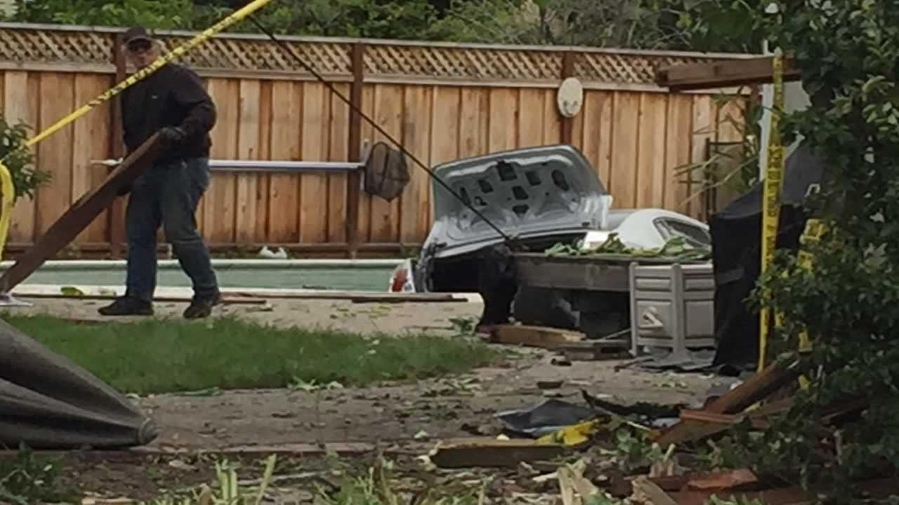 A 19-year-old says lack of sleep led him to crash his car through a fence and into the swimming pool of a Santa Clara, Calif. home on Tuesday, April 11, 2017.David Louie/KGO-TV