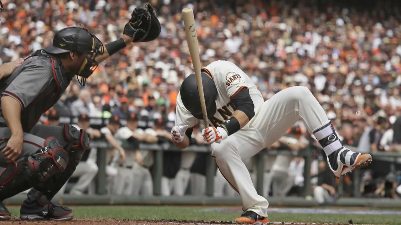 Giants Buster Posey goes falling after getting hit by Diamondbacks starting pitcher Taijuan Walker during a game, Monday, April 10, 2017, in San Francisco.