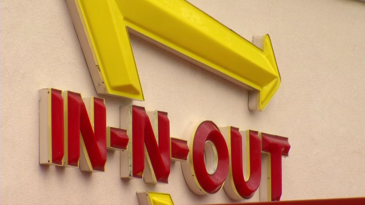 A sign for the burger fast food chain In-N-Out hangs on the side of a restaurant on Tuesday, April 11, 2017.