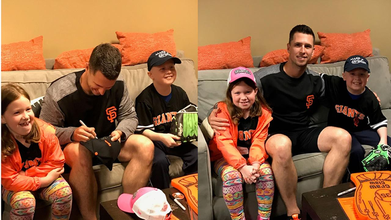 San Francisco Giants catcher Buster Posey appears with Ben Lauer (r) and his sister (l) on Tuesday, April 11, 2017, when Lauer threw out the first pitch at AT&T Park.