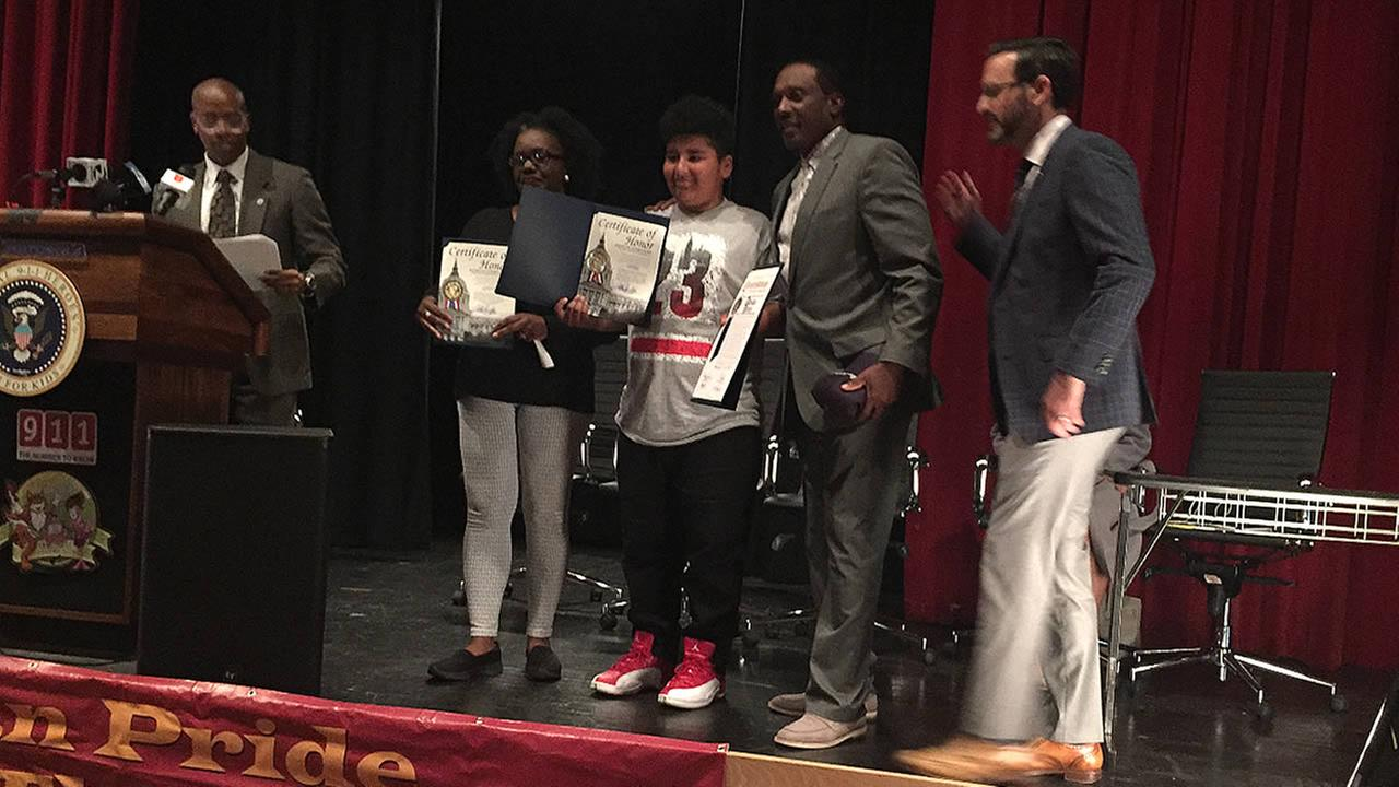Adrian Perez is seen being honored by members of James Denman Middle School in San Francisco on Wednesday, April 19, 2017.
