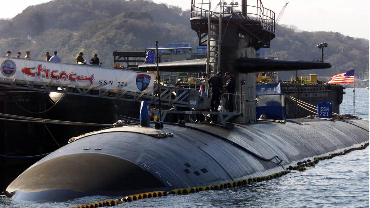 The USS Chicago, an American nuclear powered submarine, is tended to by US Navy personnel during a visit from its homeport in Pearl Harbor in this March 26, 2001 photo. (AP Photo)