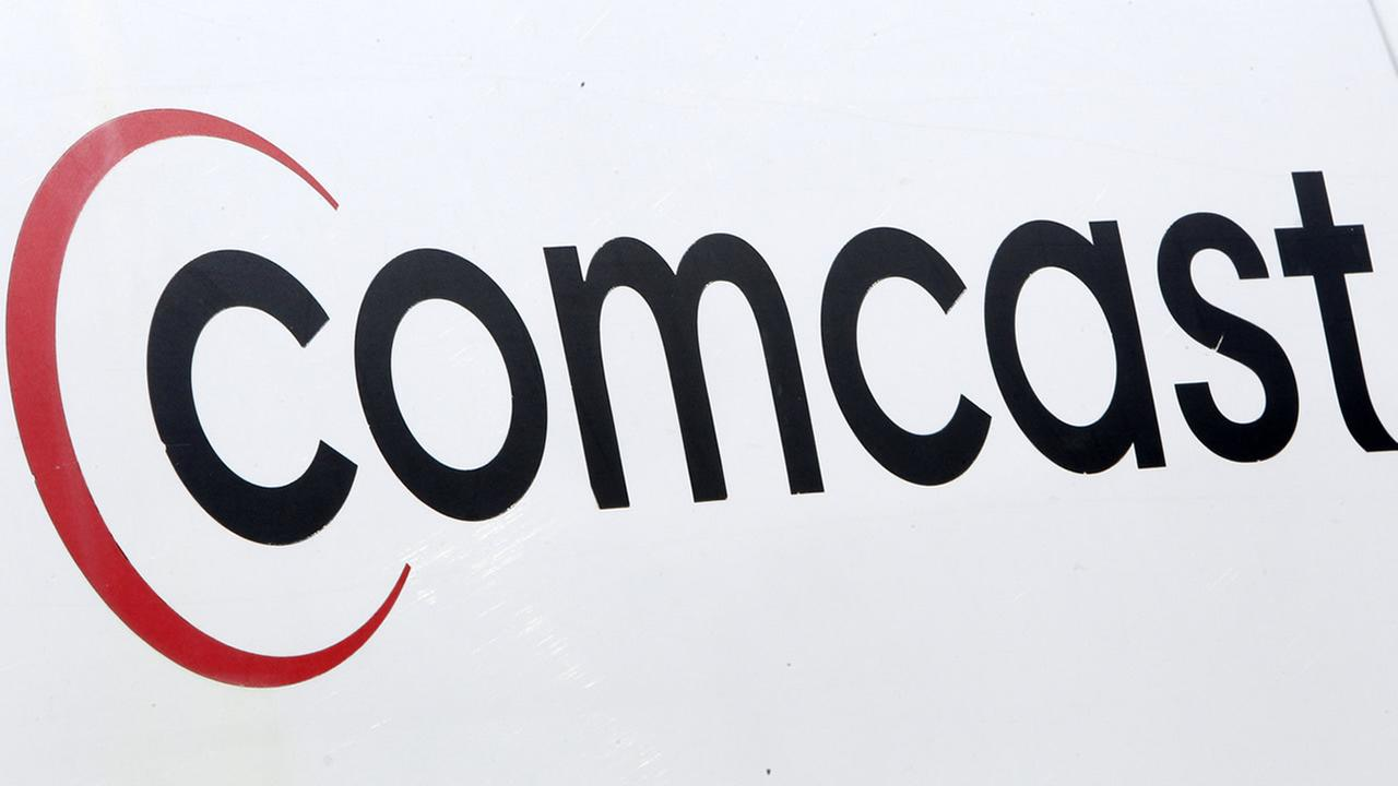 In this Feb. 15, 2011 file photo, a Comcast logo is displayed on an installation truck in Pittsburgh. (AP Photo/Gene J. Puskar, file)
