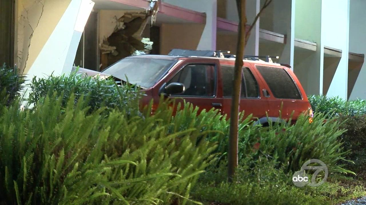 SUV slams into building in San Jose, California, Friday, April 21, 2017.