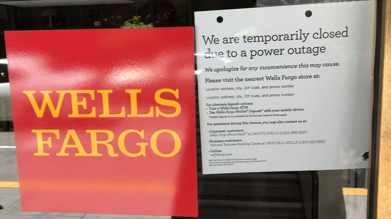 A Wells Fargo put a closed sign in its window due to a massive power outage in San Francisco on Friday, April 21, 2017.