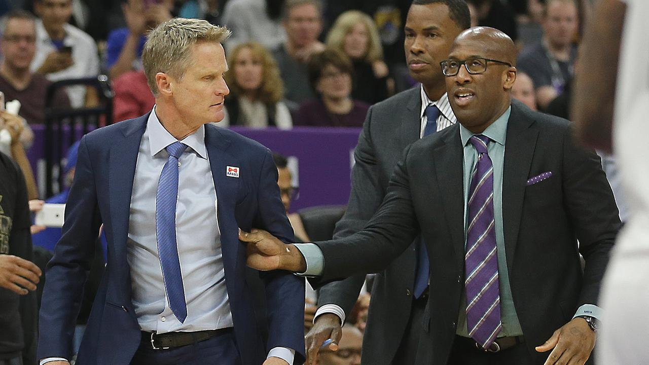 Golden State Warriors assistant coach Mike Brown, right, moves Warriors head coach Steve Kerr, Saturday, February 4, 2017.