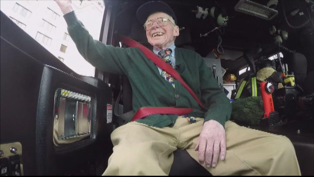Bill Grun waves from inside a fire truck on his 97th birthday in Doylestown, Pennsylvania.