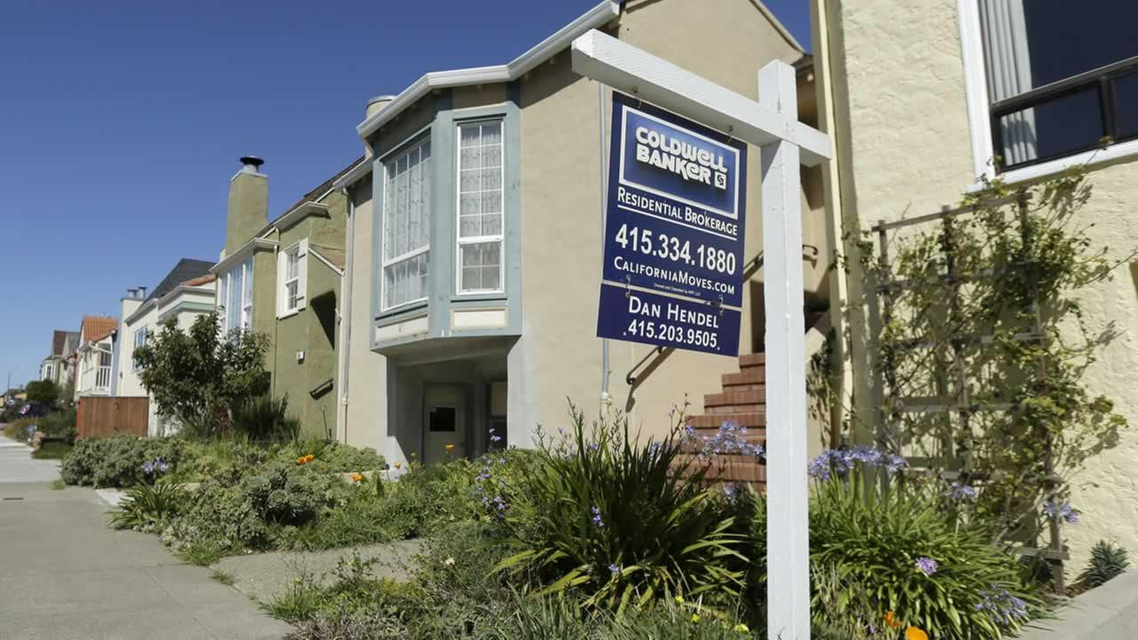 A realtor sign is shown in front of a home for sale in San Francisco, Monday, March 17, 2014.