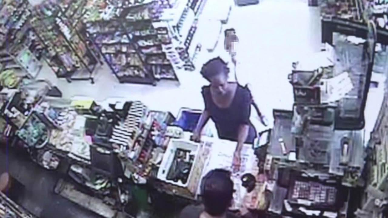 San Francisco police have released surveillance video of a woman who allegedly robbed an 8-year-old girl outside a convenience store.