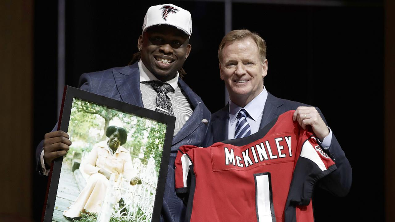 UCLAs Takkarist McKinley poses with NFL commissioner Roger Goodell after being selected by the Falcons during the 2017 NFL football draft, Thursday April 27, 2017 in Philadelphia.