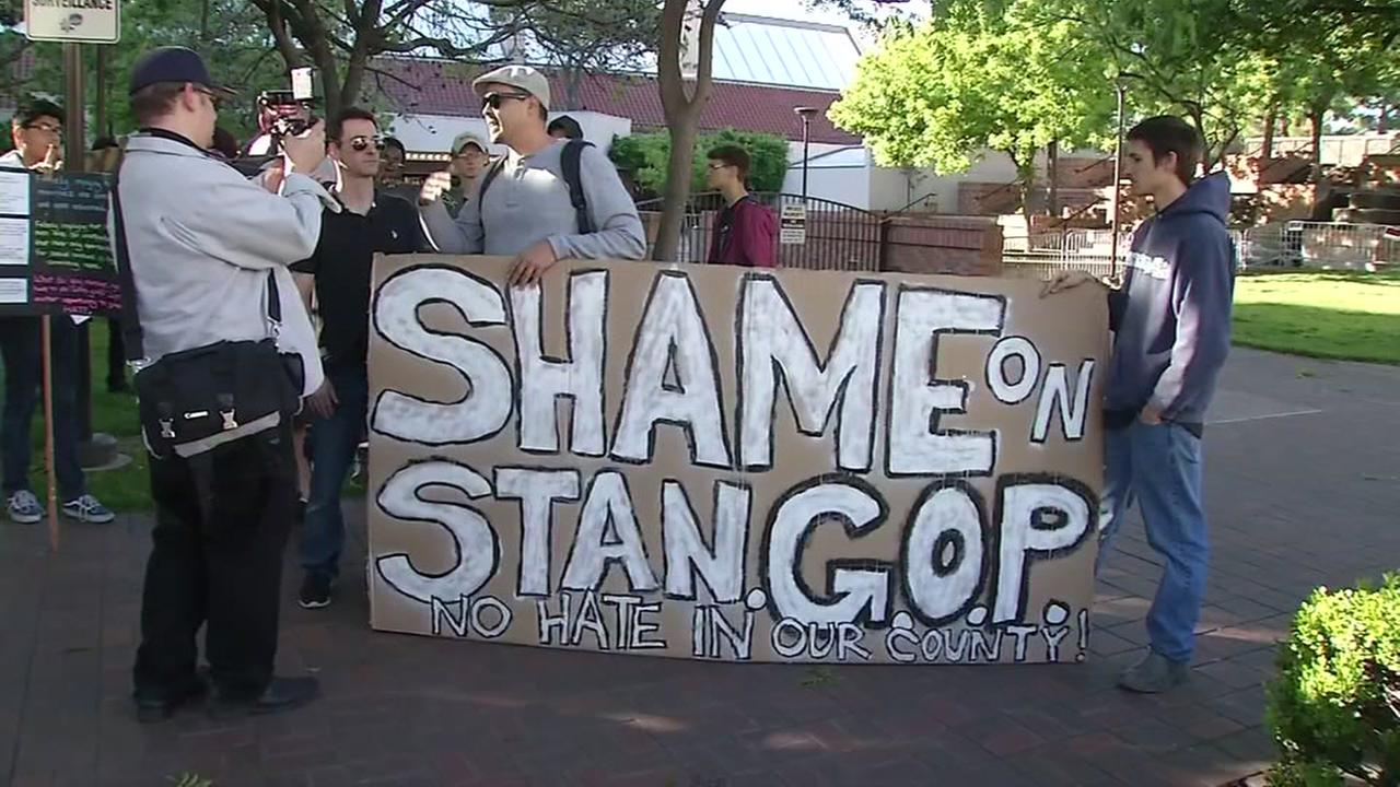 Protesters hold a sign that reads Shame on the GOP outside an Ann Coulter speaking event in Modesto, Calif. on April 28, 2017.