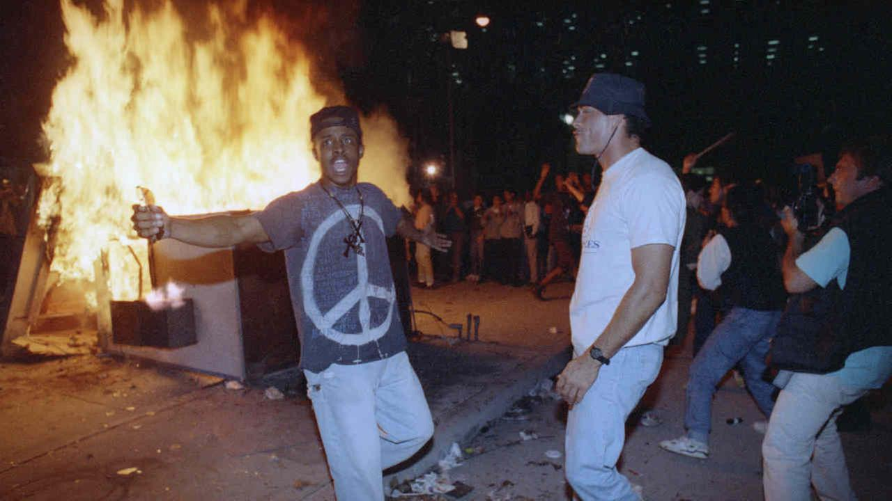 Demonstrators protest the verdict in the Rodney King beating case in front of the Los Angeles Police Department headquarters Wednesday, April 29, 1992 in Los Angeles.