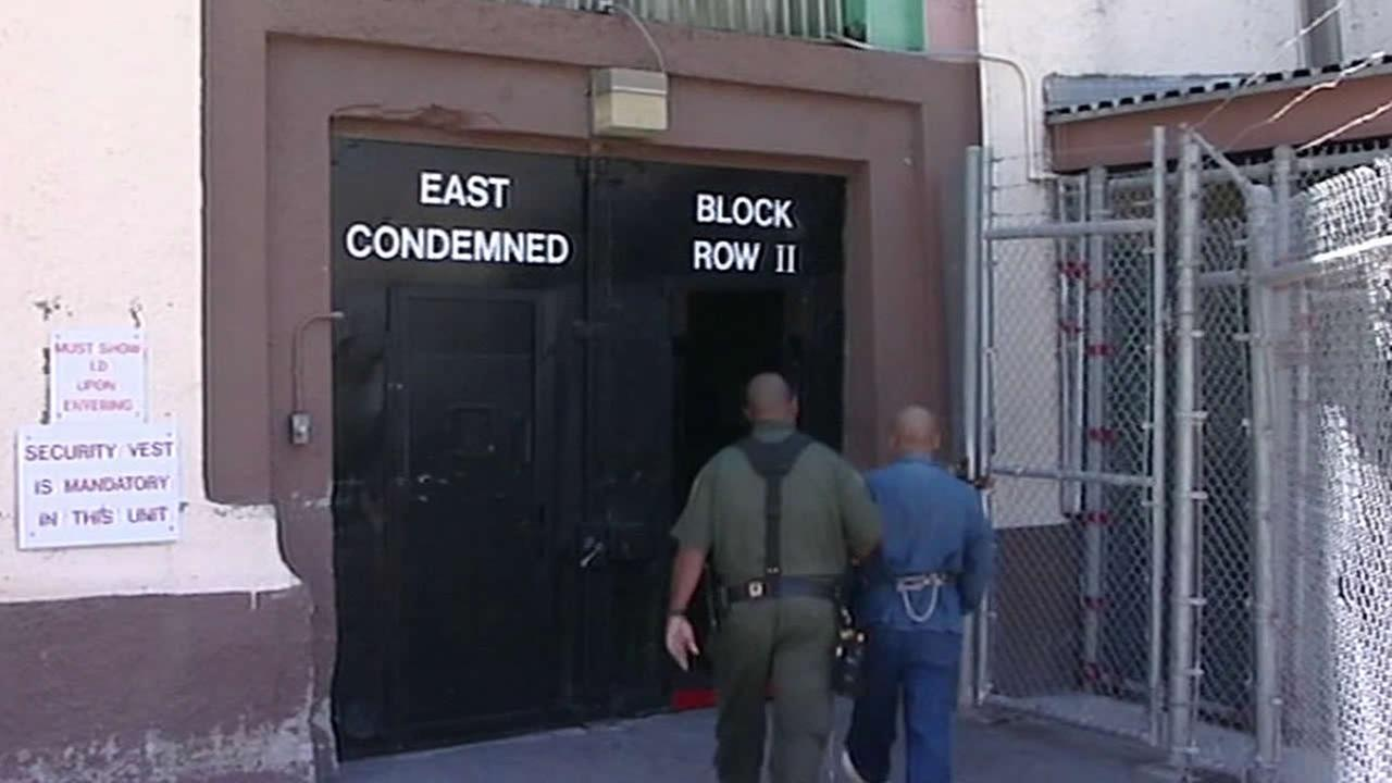 death row prisoner being walked back into building