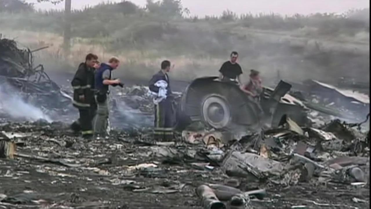 Investigators examine whats left of Malaysia Airlines Flight 17.