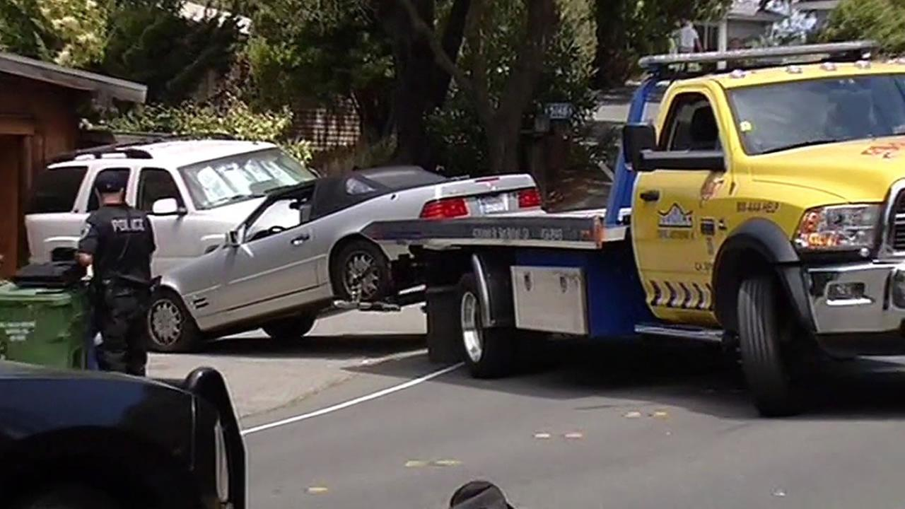 victims car being towed away from Corte Madera home