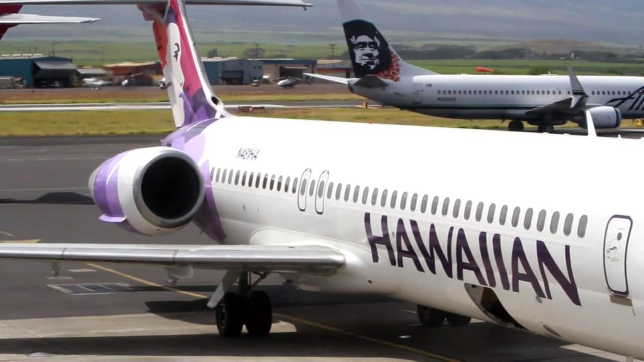 A Hawaiian Airlines plane sits on the tarmac in this file photo.