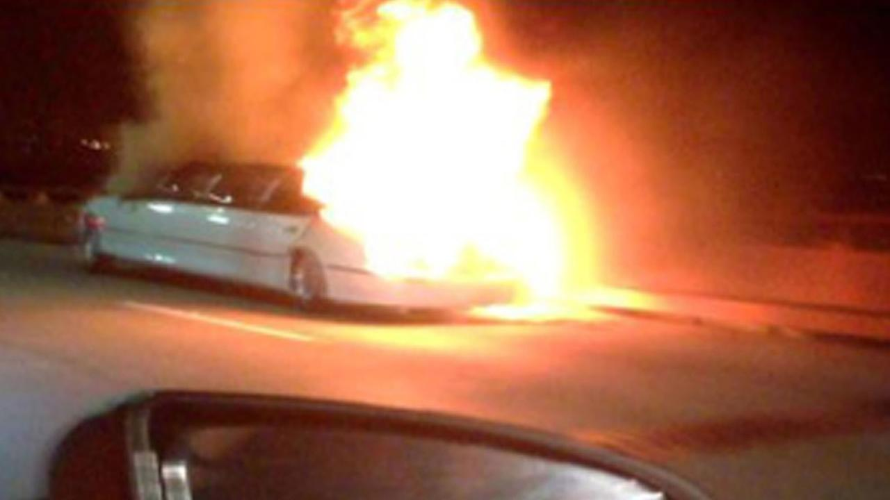 This frame grab taken from video provided by Roxana and Carlos Guzman shows a limo on fire May 4, 2013, on the San Mateo Bridge. (AP Photo/Roxana and Carlos Guzman)