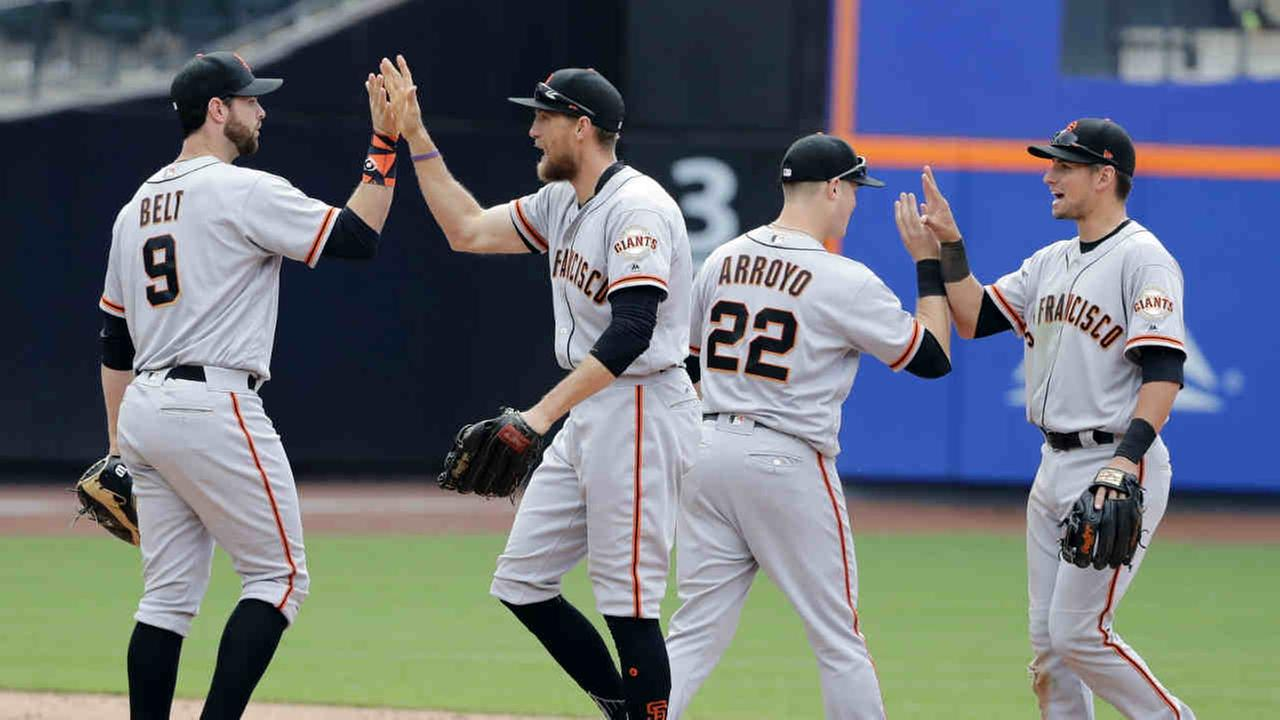 San Francisco Giants Brandon Belt (9), Hunter Pence, Christian Arroyo (22) and Joe Panik, right, celebrate after a baseball game against the New York Mets, Wednesday, May 10, 2017