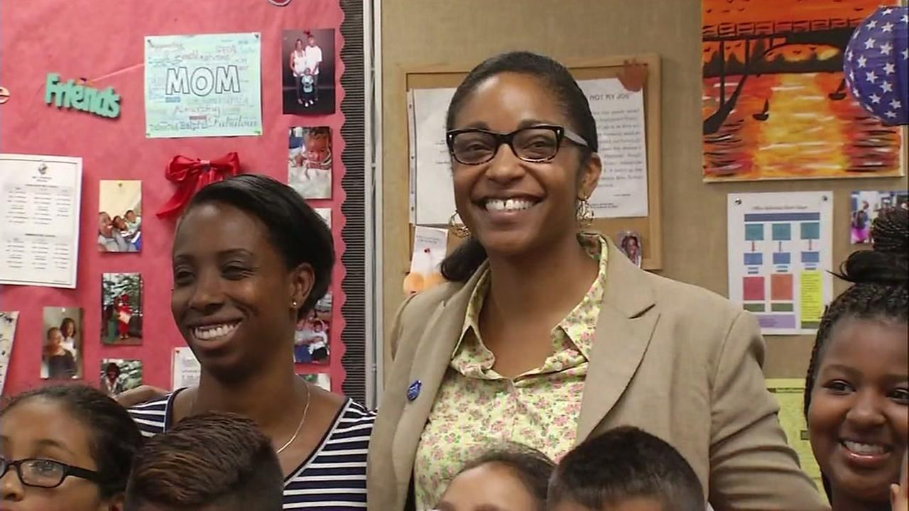 Oakland superintendent finalist Kyla Johnson-Trammell smiles with students in Oakland, Calif. on Thursday, May 11, 2017.