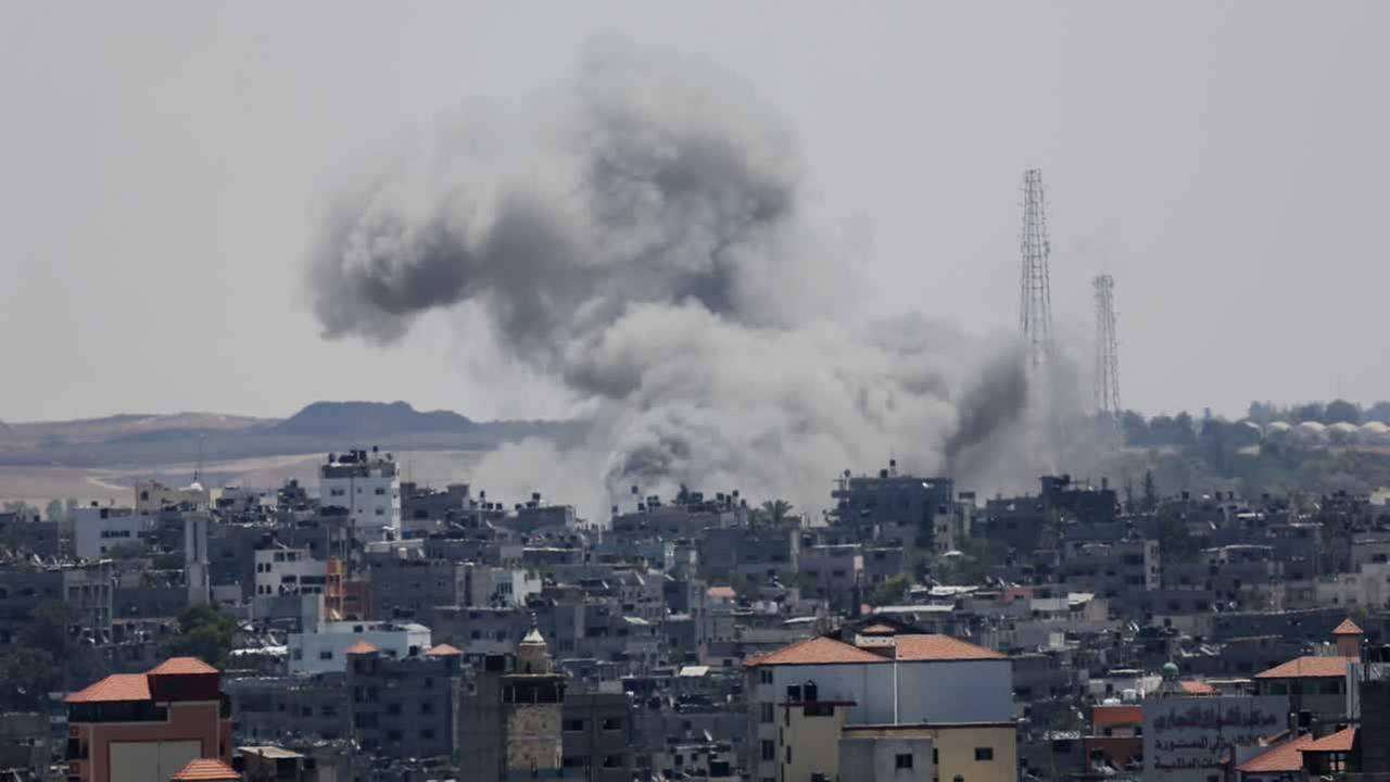 Smoke rises after an Israeli missile strike in Gaza City, Friday, July 18, 2014.