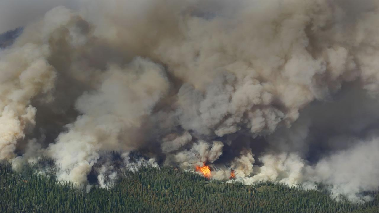 Smoke and flames rise from the Chiwaukum Creek Fire near Leavenworth, Wash., Thursday, July 17, 2014, in this aerial photo.