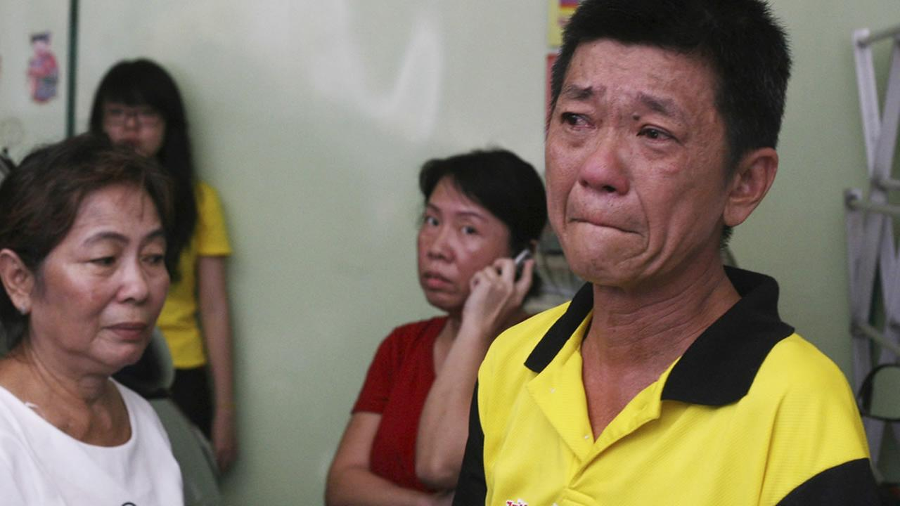 A relative of Hendry, an Indonesian passenger of the crashed Malaysia Airlines Flight 17, cries as he speaks to journalists in Medan, North Sumatra, Indonesia. (AP Photo/Binsar Bakkara)AP Photo/Binsar Bakkara