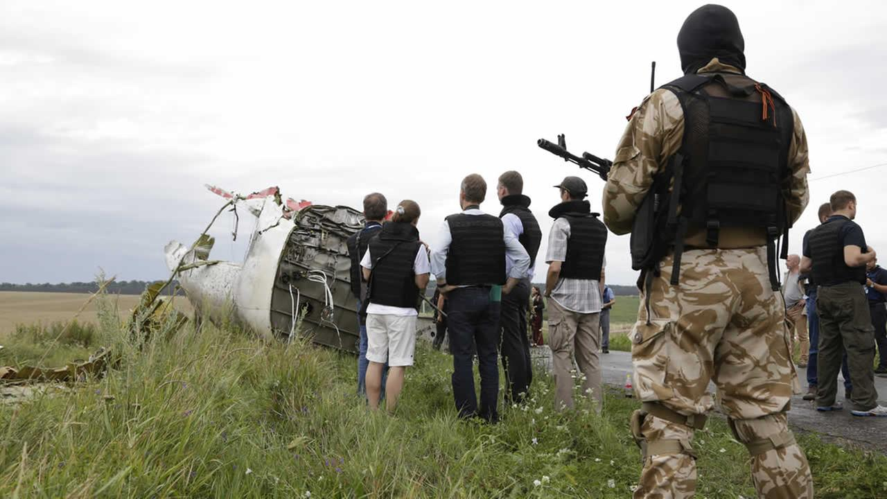 Reps from the Organization for Security and Cooperation and Ukrainian experts arrive at the crash site of the Malaysia Airlines jet, near the village of Hrabove, July 18, 2014. (AP Photo/Dmitry Lovetsky)AP Photo/Dmitry Lovetsky