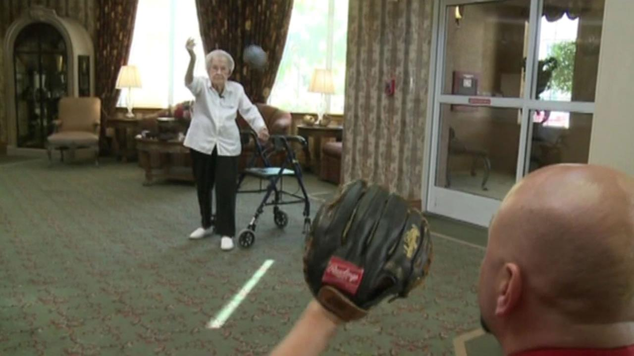 Agnes McKee, 105, warms up her pitching arm.