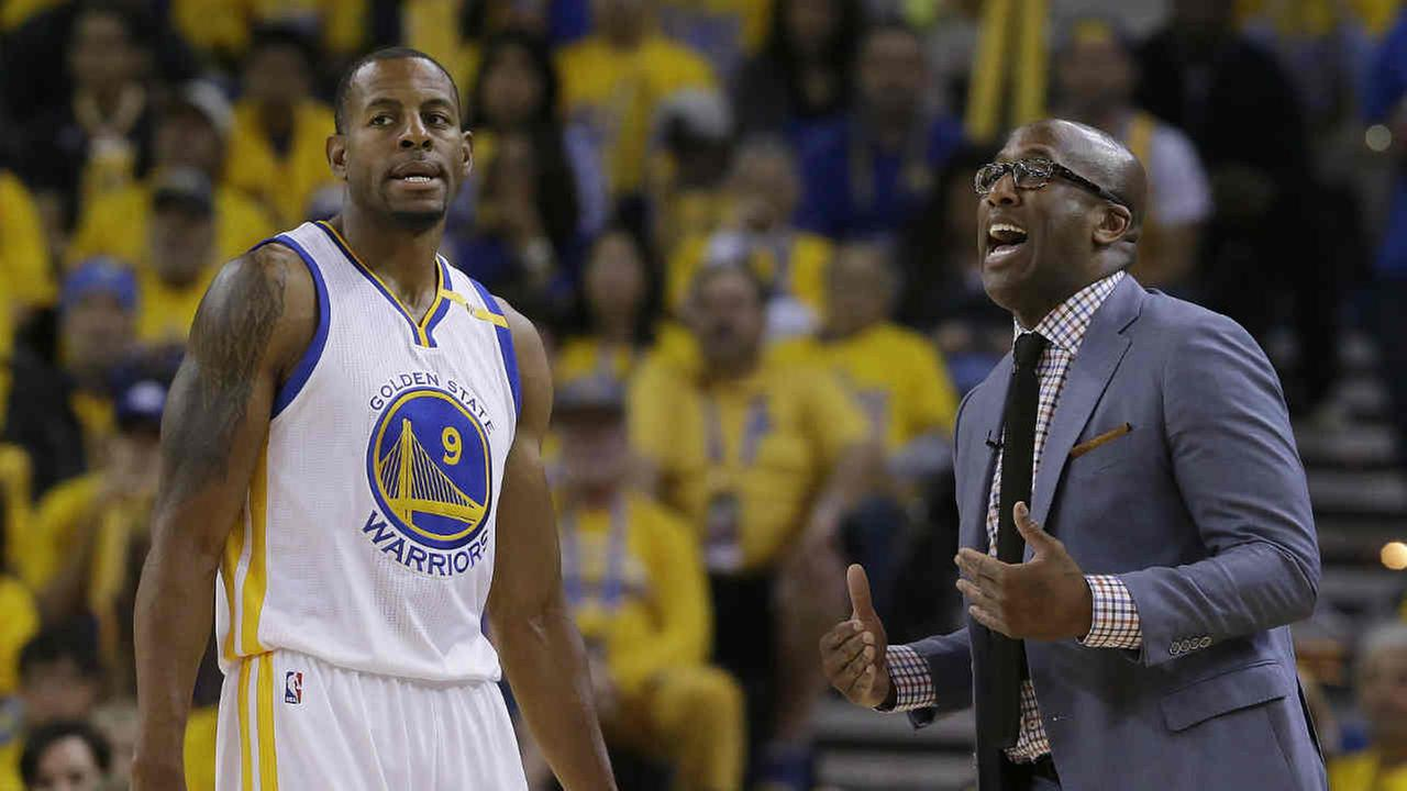 Golden State Warriors interim head coach Mike Brown, right, gestures next to forward Andre Iguodala (9).