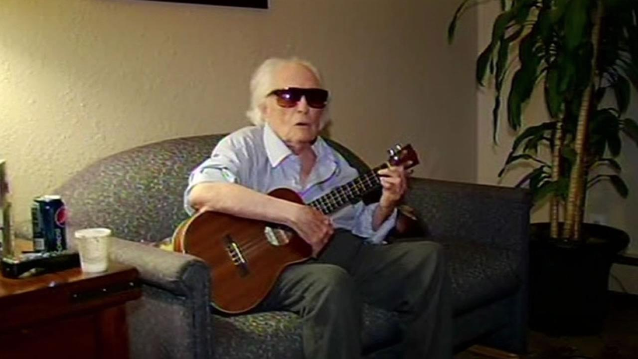 Jim Farrell playing the ukulele