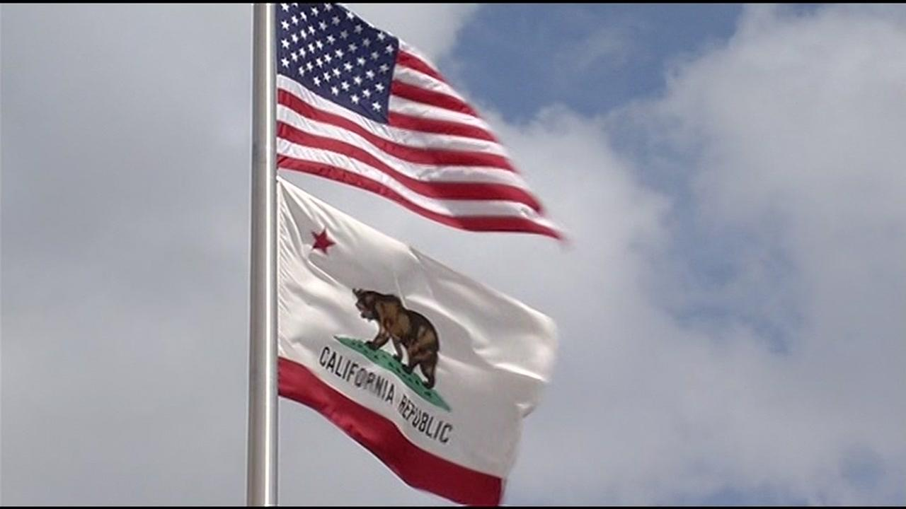 The American Flag and the California flag fly together in this undated file photo.