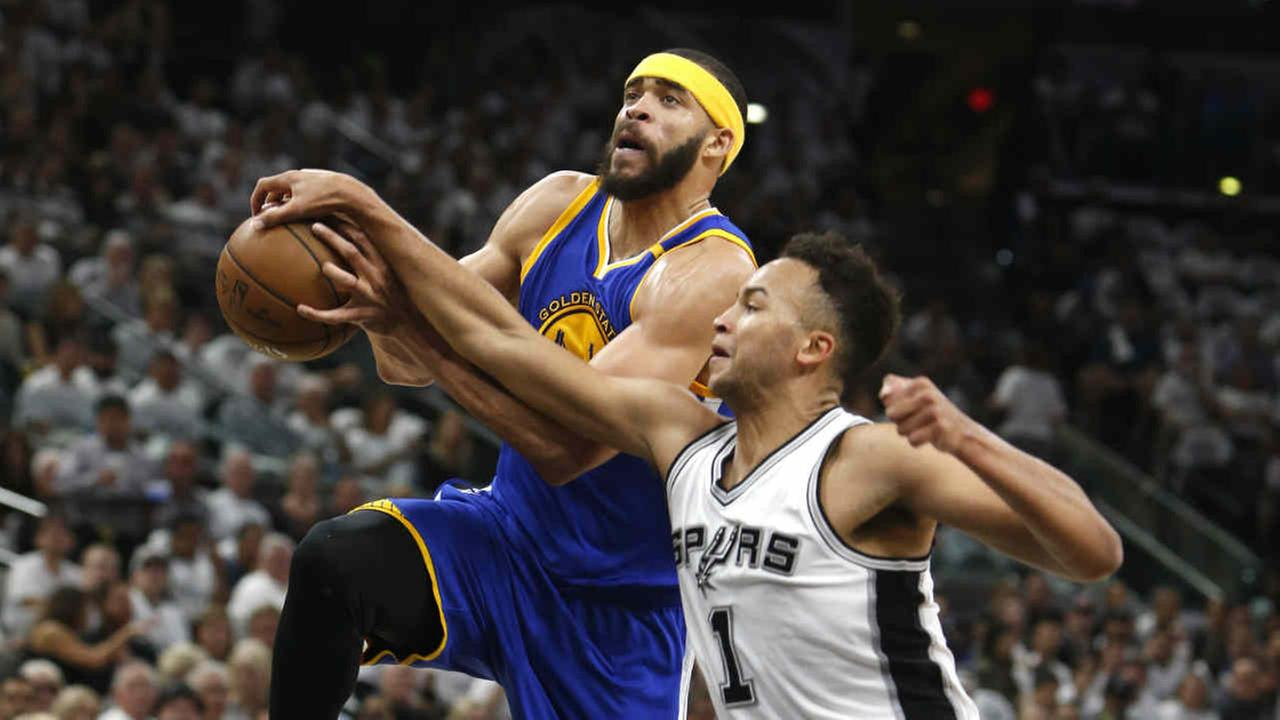 San Antonio Spurs guard Kyle Anderson knocks the ball from a driving Golden State Warriors center JaVale McGee in Game 3 of of the Western Conference finals on Sat., May 2017.